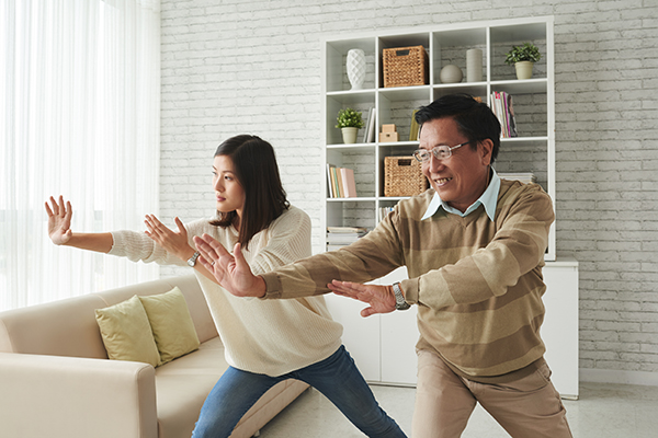 Man and woman practicing Tai Chi